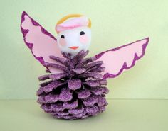Angel Christmas craft. Pinecone decorated with glitter and craft foam scraps. Copyright Pamela Maxwell 2013