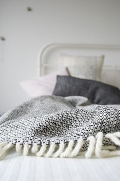 Bright, minimal bedroom, handwoven throw and cushions, Mourne Textiles