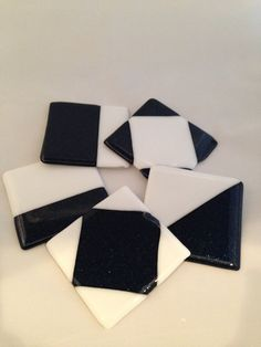 Need a pretty place for your beverage to rest between sips? Try this set of 5 coasters in blue and white. The blue has a sparkle to it. Yes, yes