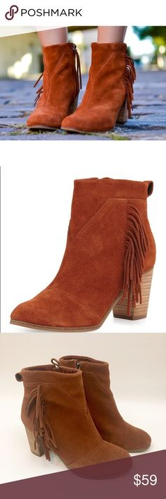 "TOMS Lunata Cognac Suede Fringe Trim Bootie New TOMS Lunata Cognac Suede Fringe Trim Bootie. Does not come with box.  Details: - Almond toe - Solid vamp - Side fringe trim - Back pull tab - Side zip closure - Stacked heel - Approx. 3"" heel - Approx.4.25"" shaft height (measured at back of shoe), 9.25"" opening circumference (measured inside shoe)  Materials: Suede upper, rubber sole Color is truest to cover photo. Minor sticky residue from price tag inside shoe. TOMS Shoes Ankle Boots…"