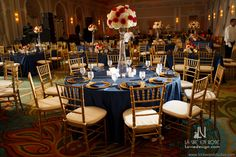 White hydrangea with red rose arrangement  and blue linens to complement the room