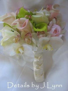 True Touch Rose, Orchid and Calla Lily Wedding Flower Bouquet and Bout. $100.00, via Etsy. customizable, lasts forever, and beats the price at my florist!