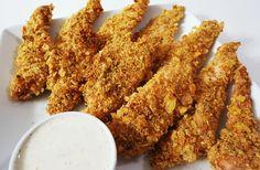A ropogós csirkefalatkákat mindenki szereti! Nagyszerű főétel és szinte minden -féle köret passzol hozzá. Hozzávalók: 50 dkg csirkemell 20 dkg kukoricapehely 5 dkg liszt 2 tojás 10 dkg reszelt sajt 2 evőkanál szezámmagolaj 1 kiskanál vaj ol...