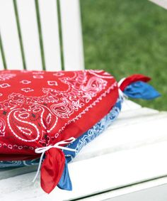 Make sitting outside a comfier prospect with these no-sew pillow covers. Place a pillow between two bandannas and use rubber bands to secure the extra fabric at each corner. Tie ribbons on top of the rubber bands for a pretty finishing touch. Get the tutorial at Good Housekeeping.   - CountryLiving.com