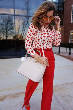valentines's day look, V-day, red wide leg pants, heart print shirt, red pumps, nude bag, henri bendel west 57th satchel, preppy style, street style, heart shape sunglasses, Russian red, bag and fur pom