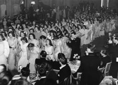 A group of white-frocked debs come out at the Queen Charlotte Ball in London, 1946. | 14 Delightful Photos Of Vintage Debutante Style