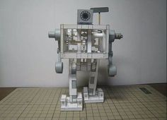 Walking Paper Robot: A new kit from a Japanese paper-modeling expert uses rubber bands to make a robot take steps. The design relies on some truly inspired engineering, Make A Robot, I Robot, Robot News, Paper Robot, Stem Steam, Model Maker, Japanese Paper, Automata, Paper Models