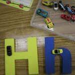 Letter Roads    I have a box of mini toy cars and large foam letters from Lakeshore. Children practice letter formation by driving the cars around the letters.