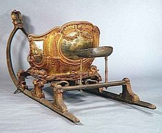 """Traineau """"Chinese Games"""" from 1735 preserved in Carriage Museum at Versailles  is a box with two seats ornamented with exotic designs placed in the back seat shifted a third tie. But the walking paths and roads could leave and be carried out on the ponds, canals and lakes frozen with lighter sleds like this sled """"the skater""""."""
