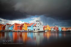 Multicolored buildings on water in storm by catolla #architecture #building #architexture #city #buildings #skyscraper #urban #design #minimal #cities #town #street #art #arts #architecturelovers #abstract #photooftheday #amazing #picoftheday