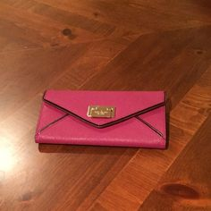 SALENWT Kate Spade Cyndy Wesley Place Wallet NWT Kate Spade Cyndy Wesley Place Wallet in Red Plum. Kate Spade metal flip closure. 12 credit card slots and zip closure in the middle inside. Slip pocket in the back. Kate Spade lining on the outside. Discount if you purchase the wallet and matching bag. Originally listed at $130. Sale ends 2/7/16. kate spade Bags Wallets