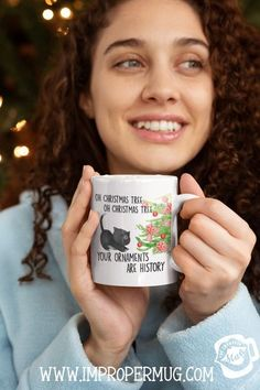 Christmas Mug Gift Ideas | Cute Cat Christmas Mug – Oh Christmas Tree Your Ornaments are History | Get useful and fun Christmas gifts for the entire family. Snarky, personalized, or sweet we have something to bring every personality some good cheer for the holidays. Design printed using a sublimation process making the design part of the mug surface. Prints are high quality and won't scratch, peel or fade away over time #ChristmasMugs #MugsforChristmas #ChristmasGiftIdeas #GiftIdeas