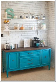 great for wall in kichen - Use a piece of furniture in the kitchen (rather than extra cabinets).  It