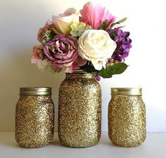 golden mason jar wedding decorations-- not a dan of the glitter, but painting the inside gold would be nice with baby's breath