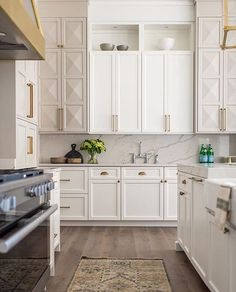 Beautiful kitchen design with detailed white cabinets | Whittney Parkinson
