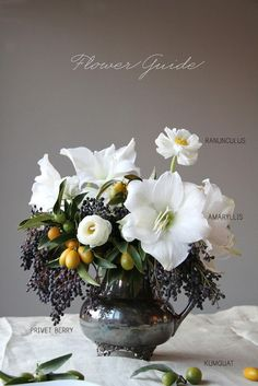 Love the big white amaryllis too if available! replace the kumquats with dark little artichokes or cabbage. Ranunculus, amaryllis, privet berry Honey of a Thousand Flowers / Sarah Winward: ranunculus, amarylis, privet berries