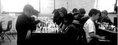 Rows of tables lined with black and white squares, strategizing eyes create a productive kind of quiet on a Saturday afternoon at The Mosaic School. The fourth annual Étude Group Chess Tournament was held on February 14th, 2015 as part of the Wisconsin Scholastic Chess Federation.