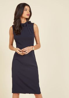 You like to keep your aesthetic simple so your innovation can really flourish - which is why this navy blue dress is just right for you! Touting a high neckline topped with a tidy bow, a tailored silhouette, and a back vent, this professional midi stylishly stays out of the way so you can connect the dots to come up with most inventive solutions.