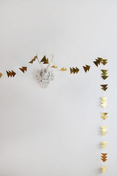 so pretty and modern and simple - diy simple gold triangle garland