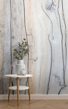 Enjoy whitewashed wooden panels in your dining room without actually incorporating new materials to the original structure. The Driftwood Detail Wallpaper proves that there is beauty in the rustic things of life, and adds a real sense of texture to a Scandinavian style dining room. #ihavethisthingwithwalls #scandinavian #nordic #scandi #scandidecor #scandinaviandesign #nordicdesign #texturewallpaper #diningroom #diningroomideas #scandinaviandiningroom