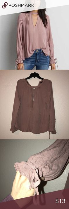 American eagle top Size medium has a small stain on the front (AS PICTURED) and it's a little wrinkled from being in my drawer I just don't wear this top like I wish I would! My arms are way too long for it 😩 it's still in great condition & is so CUTE on! The back is button up and it's very airy! American Eagle Outfitters Tops Blouses