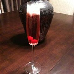 Ginger Grant 1 cup ice cubes  3 fluid ounces whiskey  1 fluid ounce chilled ginger ale  1 dash grenadine syrup  1 maraschino cherry