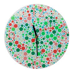 "Color Test Of Time  Seeing spots? Good news! You're healthy. The real test here: Look a little closer to make out hidden numbers in this timely spin on the classic Ishihara color test. Hang one in your home or office to make time checks a fun and colorful check-up. Talk about clocking in! Made in the U.K.  Item ID: 20839  Materials: glass, metal  12"" dia.  Comes ready-to-hang. Requires 1 AA battery, not included."