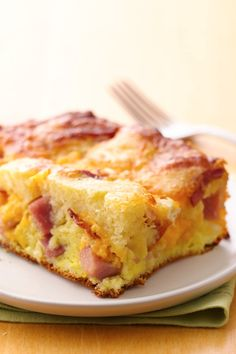 Gather family for a bacon and ham, double cheesy, puffy pancake!