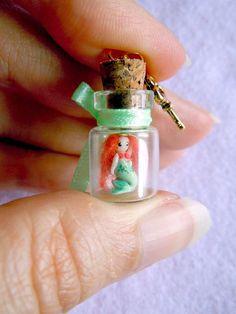 Tiny mermaid in a bottle