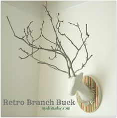 Retro Branch Buck. Would do head in newspaper with branches against the wall branching out, painted teal.