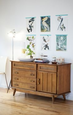 Midcentury side cabinet with natural prints