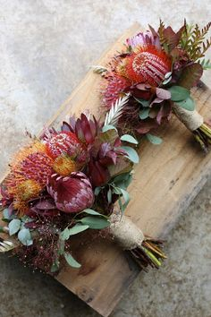 We love the warm, autumnal colours in these bouquets. We love the warm, autumnal colours in these bouquets. Protea Wedding, Floral Wedding, Wedding Bouquets, Flower Bouquets, August Wedding Flowers, Bridal Flowers, Colourful Wedding Flowers, Wedding Flower Arrangements, Floral Arrangements