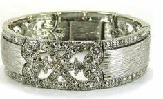 Crystal Rhinestone Silver Tone Cuff Statement Bracelet for Women LaRaso & Co. $17.99. Adjustable to Fit Most. Infinity Design. Antique Style Details on Face