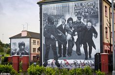 A mural by by the Bogside Artists, in Bogside, Derry - Bloody Sunday Bogside