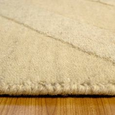 """AllStar Rugs Ivory Solid Color Wool Rug. Size: 4'11"""" x 7'0"""""""