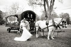 rustic vintage fall wedding horse and carriage