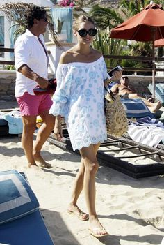 rotate xx Olivia Palermo clutches her phone and beach bag as she heads to the boat