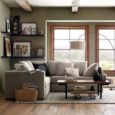 shelves behind sectional... Mix something like this with straight floating shelves for the TV.