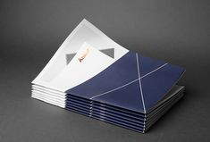 branded print material in blue, white, gray and gold foil ( La Tortillería for the project Ankor)