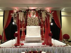 Gorgeous Reception Decor backdrop w floral canopy for this GTA Couple. Red and gold w black bold colours.