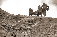 With an unprecedented scale of trench warfare and enormous losses on all sides of the conflict, World War I devastated Europe. This photograph shows stretcher bearers carrying a wounded man during the Battle of the Somme, France. World War One, First World, Schlacht An Der Somme, Treaty Of Versailles, Battle Of The Somme, Flanders Field, Holocaust Memorial, Memorial Museum, Wwii