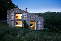 In the Spanish countryside, a stable in ruin is reborn in a modern, off-grid ranch home.