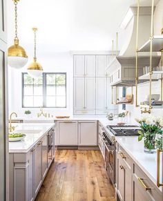 Brass open shelving by hood, uppers that sit on lowers by sink