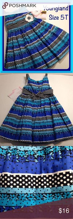 NEW Youngland Blue and Black Dress, Girls Size 5T Youngland sleeveless spring/summer dress. Cotton fabric has stripes made up of various patterns and combinations of the colors aqua, turquoise, blue, black and white. There is a tiered waistband of black and white polka dot fabric accented with a white and black flower. The skirt is gathered and has a white underskirt with white net crinoline. There are buttons up the back and black and white polka dot tie backs. Brand new with tags. Girls…