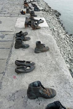 Shoe Sculpture on the Danube - Budapest    During World War II, the Arrow Cross (Hungarian Fascists) would take Jews from the Budapest ghetto down to the Danube River and shoot them so that they would fall into the river. These shoes (bronze but in the style of that era) are lined up along the Embankment, not far from the location of the Hungarian Parliament. Missed this.