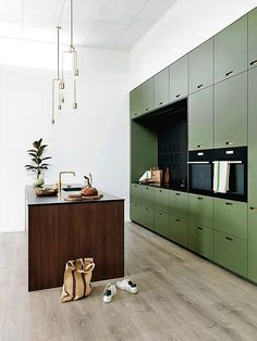 Large green kitchen wall with dark wooden island, kitchen with four . - Large green kitchen wall with dark wooden island, kitchen with lots of storage space, modern kitchen - Green Kitchen Walls, Green Kitchen Cabinets, Ikea Kitchen, Kitchen Decor, Kitchen Ideas, Kitchen Hacks, Kitchen Colors, Dark Green Kitchen, Kitchen Faucets