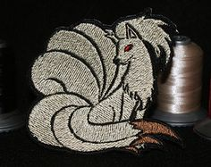 Ninetales - Iron or sew on patch.  Beautiful shimmer and detail!  Perfect gift for the Pokemon lover in your life to accompany the release of Sun and Moon.