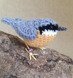 Realistic British nuthatch crochet bird sculpture. By Jose Heroys Fibre Artist
