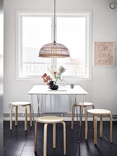 Simple dining room with Ikea 'Frosta' stools & basket lamp