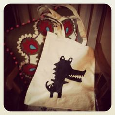 More of my  tote bag creations, named, oh so cleverly 'snappy' the crocodile. I added some badges that I made to this made to add colour and texture.